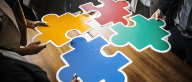 Cross sector partnership puzzle pieces